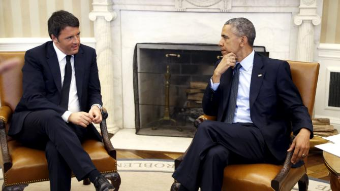 Obama speaks with Renzi at the start of their meeting in the Oval Office at the White House in Washington