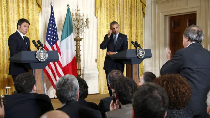 U.S. President Obama and Italian Prime Minister Renzi listen to a question during joint news conference at the White House in Washington