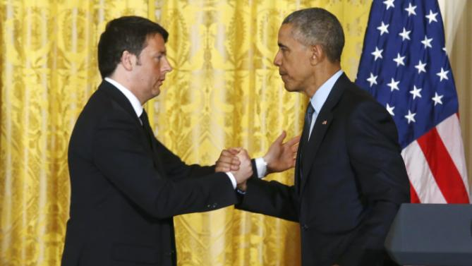 U.S. President Obama greets Italian Prime Minister Renzi after their joint news conference at the White House in Washington