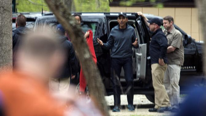 U.S. President Barack Obama steps out from his vehicle as he, U.S. First Lady Michelle Obama, and their daughters Malia and Sasha arrive for a hike at Great Falls National Park in Virginia