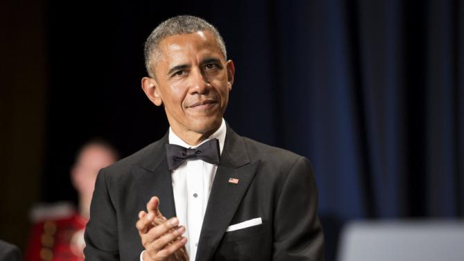 U.S. President Barack Obama applauds as he arrives at the 2015 White House Correspondents' Association Dinner