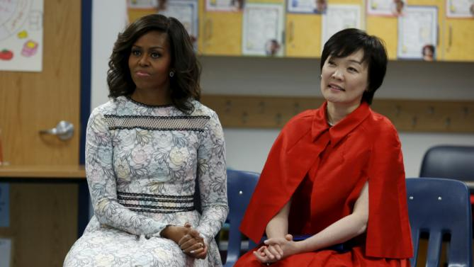 U.S. First Lady Michelle Obama and Mrs. Akie Abe, wife of Japanese Prime Minister Shinzo Abe, visit Great Falls Elementary School in Great Falls
