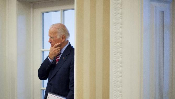 Vice President Joe Biden listens to remarks to the media during a meeting between President Barack Obama and NATO Secretary General Jens Stoltenberg, Tuesday, May 26, 2015, in the Oval Office of the White House in Washington. (AP Photo/Pablo Martinez Monsivais)