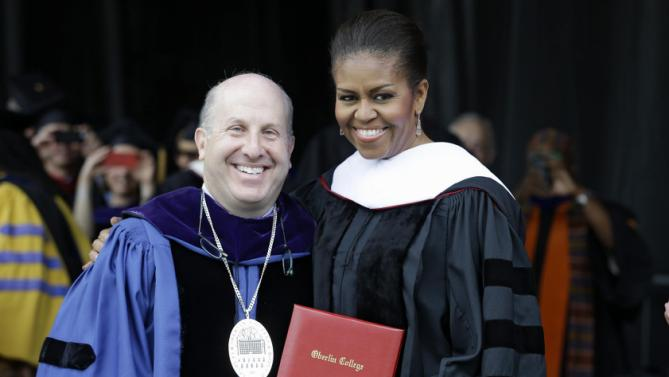 First lady Michelle Obama poses with Oberlin College President Marvin Krislov after receiving an Honorary Degree of Doctor of Humanities, Monday, May 25, 2015, in Oberlin, Ohio. (AP Photo/Tony Dejak)