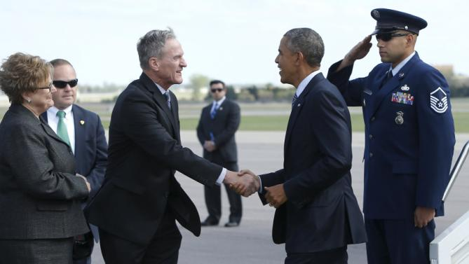 U.S. President Barack Obama (2nd R) is greeted by South Dakota Governor Dennis Daugaard (2nd L) and his wife Linda Daugaard (L) as he arrives aboard Air Force One at Watertown Regional Airport in Watertown, South Dakota May 8, 2015. Obama's touchdown in South Dakota marks his first visit to the state as sitting president, and he has now visited all 50 U.S. states during his time in office. REUTERS/Jonathan Ernst
