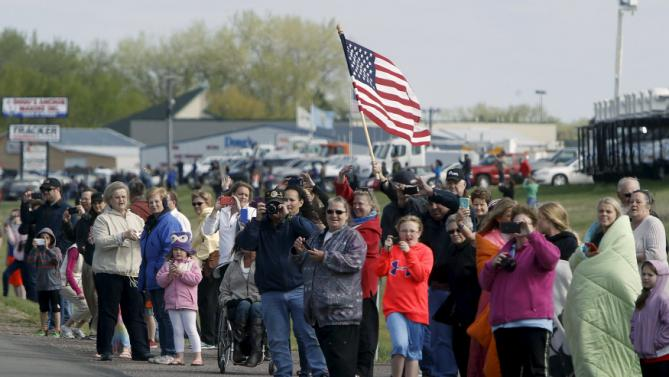 People line the motorcade route as U.S. President Barack Obama arrives for a commencement address in Watertown, South Dakota May 8, 2015. Obama's touchdown in South Dakota marks his first visit to the state as sitting president, and he has now visited all 50 U.S. states during his time in office. REUTERS/Jonathan Ernst