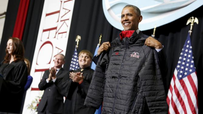 U.S. President Barack Obama receives a school jacket from graduates after his commencement address to the graduating class at Lake Area Technical Institute in Watertown, South Dakota May 8, 2015. REUTERS/Jonathan Ernst