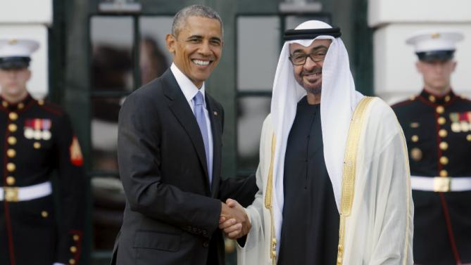 U.S. President Barack Obama (L) welcomes UAE Crown Prince Sheikh Mohammed bin Zayed al-Nahyan as he plays host to leaders and delegations from the Gulf Cooperation Council countries at the White House in Washington May 13, 2015.  REUTERS/Jonathan Ernst