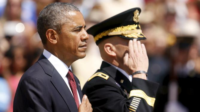 U.S. President Barack Obama (L) and U.S. Army Military District of Washington Commanding General Jeffrey Buchanan participate in the wreath-laying ceremony at the Tomb of the Unknown Soldier as part of the Memorial Day observance at Arlington National Cemetery in Arlington, Virginia May 25, 2015.  REUTERS/Jonathan Ernst