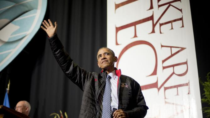 President Barack Obama waves after delivering the commencement address at Lake Area Technical Institute, Friday, May 8, 2015 in Watertown, S.D. Obama visited South Dakota to promote his proposal to offer two years for free community college to qualified students. (AP Photo/{photo})