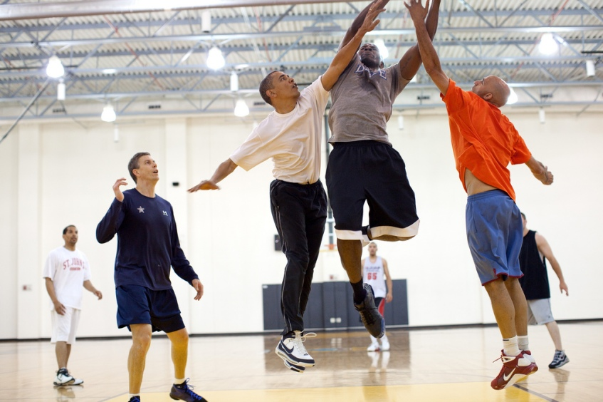 President Barack Obama attempts to block a shot by personal aide Reggie Love, during a basketball game at Fort McNair in Washington, D.C. , May 16, 2010. Secretary of Education Arne Duncan, left, watches the play. (Official White House Photo by Pete Souza) This official White House photograph is being made available only for publication by news organizations and/or for personal use printing by the subject(s) of the photograph. The photograph may not be manipulated in any way and may not be used in commercial or political materials, advertisements, emails, products, promotions that in any way suggests approval or endorsement of the President, the First Family, or the White House.