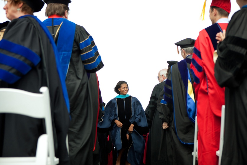 First Lady Michelle Obama attends the commencement ceremony at George Washington University on the National Mall in Washington, D.C., May 16, 2010. Mrs. Obama delivered the commencement address after student made good on her challenge to do 100,000 hours of service in exchange for a graduation speech. (Official White House Photo by Samantha Appleton) This official White House photograph is being made available only for publication by news organizations and/or for personal use printing by the subject(s) of the photograph. The photograph may not be manipulated in any way and may not be used in commercial or political materials, advertisements, emails, products, promotions that in any way suggests approval or endorsement of the President, the First Family, or the White House.