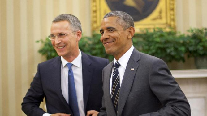 President Barack Obama and NATO Secretary General Jens Stoltenberg, get up from their seats following their meeting, Tuesday, May 26, 2015, in the Oval Office of the White House in Washington. (AP Photo/Pablo Martinez Monsivais)