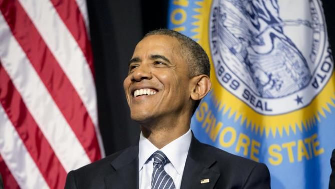 President Barack Obama smiles on stage as he waits to deliver the commencement address at Lake Area Technical Institute, Friday, May 8, 2015 in Watertown, S.D. Obama visited South Dakota to promote his proposal to offer two years for free community college to qualified students. (AP Photo/{Pablo Martinez Monsivais)