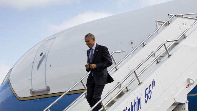 President Barack Obama walks down the steps during his arrival on Air Force One at Watertown Regional Airport Friday, May 8, 2015 in Watertown, S.D. Obama traveled to South Dakota to deliver the commencement address at Lake Area Technical Institute, where he will promote his proposal to offer two years of free community college to qualified students. (AP Photo/Pablo Martinez Monsivais)
