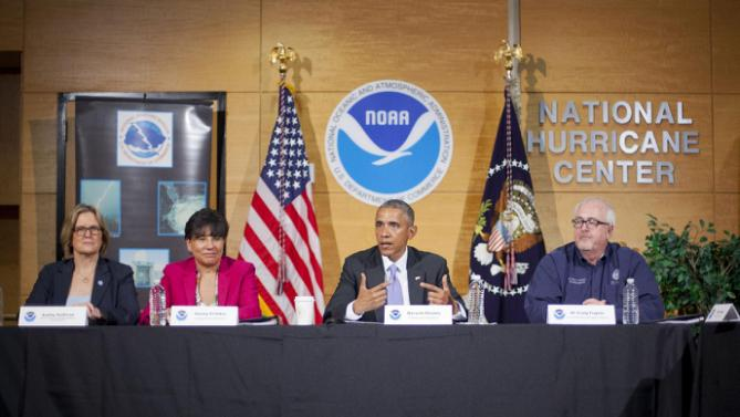 President Barack Obama speaks after receiving a briefing at the National Hurricane Center in Miami, Thursday, May 28, 2015, to draw attention to preparedness in advance of the annual storm season that formally begins June 1. From left are, NOAA Administrator Kathy Sullivan; Commerce Secretary Penny Pritzker and Federal Emergency Management Agency (FEMA) Administrator Craig Fugate (AP Photo/Pablo Martinez Monsivais)