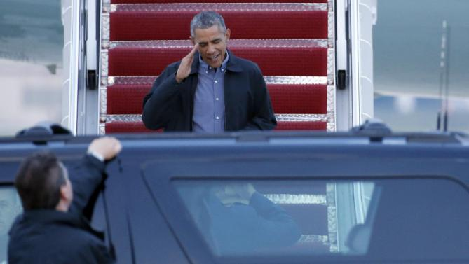 President Barack Obama salutes as he descends off Air Force One as he arrives Monday, June 8, 2015, at Andrews Air Force Base, Md., as he returns from the G-7 Summit in Germany. (AP Photo/Alex Brandon)