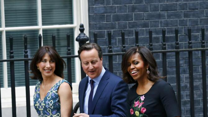 U.S. first lady Michelle Obama (R) is welcomed by Britain's Prime Minister David Cameron and his wife Samantha at Number 10 Downing Street in London June 16, 2015. REUTERS/Darren Staples