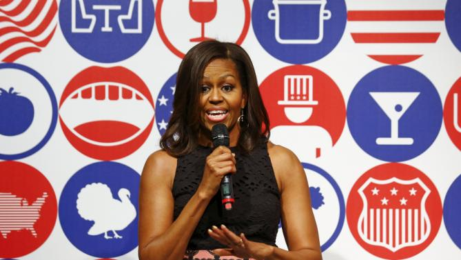 U.S. first lady Michelle Obama talks at James Beard American Restaurant in Milan, Italy, as part of her European trip, June 17, 2015.  REUTERS/Stefano Rellandini      TPX IMAGES OF THE DAY