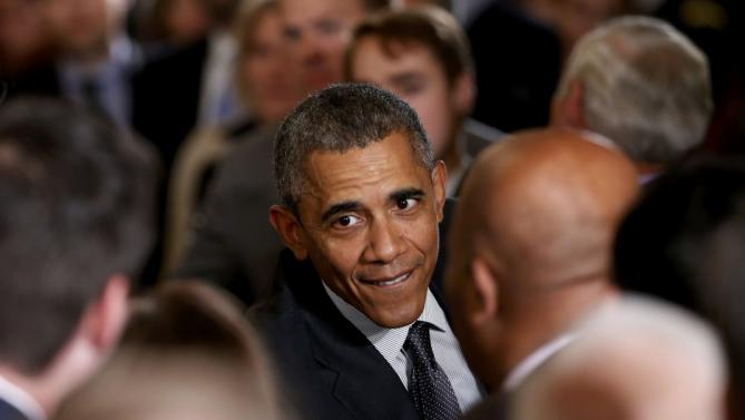 "U.S. President Barack Obama greets attendees in the crowd after signing House Resolution 2146, the ""Defending Public Safety Employees' Retirement Act and Trade Preference Extension Act of 2015,""  during a ceremony in the East Room of the White House in Washington June 29, 2015. REUTERS/Jonathan Ernst"