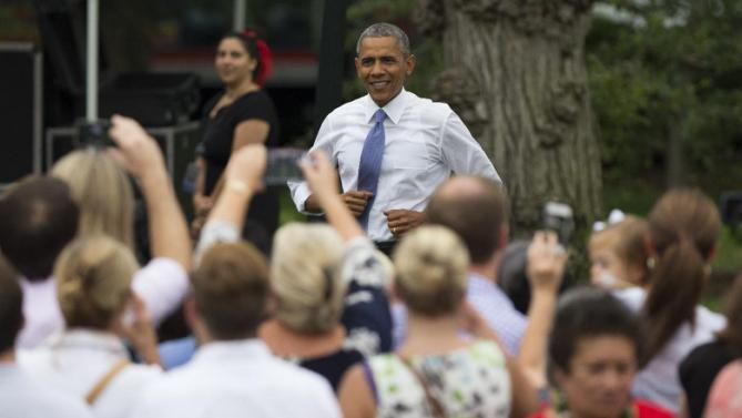 President Barack Obama arrives for a picnic for Members of Congress on the South Lawn of the White House, on Wednesday, June 17, 2015, in Washington. (AP Photo/Evan Vucci)