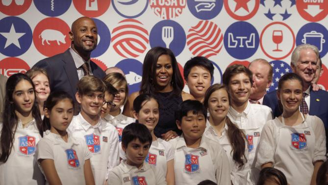 U.S. first lady Michelle Obama poses after a cooking demonstration at the James Beard American Restaurant with Italian and American middle school students in Milan, Italy, Wednesday, June 17, 2015.  Michelle Obama is in Milan on the second leg of a European trip that puts an international spin on her core initiatives. (AP Photo/Antonio Calanni)