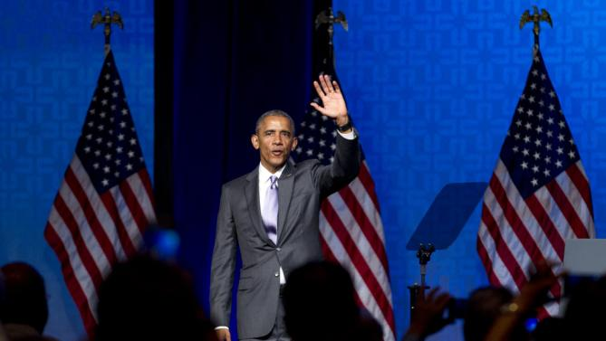 President Barack Obama waves to the crowd during Catholic Hospital Association Conference in Washington on Tuesday, June 9, 2015.  Obama defended the health care overhaul just days ahead of an anticipated decision by the Supreme Court that could eliminate health care for millions of people.  (AP Photo/Jose Luis Magana)