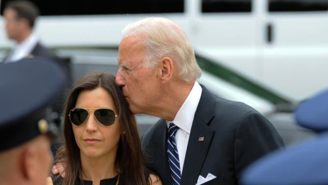 Vice President Joe Biden consoles Hallie Biden wife of former Delaware Attorney General Beau Biden before a viewing at Legislative Hall in Dover, Del. Biden, the vice president's eldest son, died of brain cancer Saturday at age 46.  (Jason Minto/The Wilmington News-Journal via AP)  NO SALES