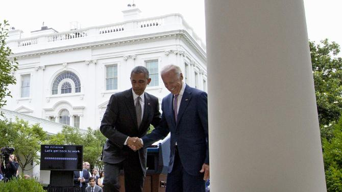 President Barack Obama and Vice President Joe Biden shake hands as they leave the Rose Garden to walk back to the Oval Office of the White House in Washington, Thursday, June 25, 2015, after the president spoke in the Rose Garden about the U.S. Supreme Court upholding the subsidies for customers in states that do not operate their own exchanges under President Barack Obama's Affordable Care Act. (AP Photo/Carolyn Kaster)