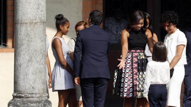"Agnese Landini, right, wife of Italian premier Matteo Renzi, and U.S. first lady Michelle Obama look at young Ester Renzi, as Italian premier Matteo Renzi, back to camera, talks with Sasha Obama and Marian Robinson during a visit at the Santa Maria delle Grazie church to see Leonardo's masterpiece ""The Last Supper"", after participating in a cooking demonstration at the James Beard American Restaurant with Italian and American middle school students in Milan, Italy, Wednesday, June 17, 2015.  Michelle Obama is in Milan on the second leg of a European trip that puts an international spin on her core initiatives. (AP Photo/Antonio Calanni)"