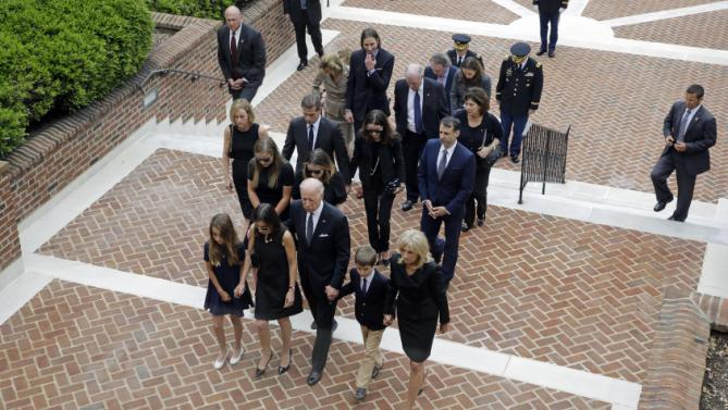 Vice President Joe Biden, bottom center, leads his family to a viewing for his son, former Delaware Attorney General Beau Biden, Thursday, June 4, 2015, at Legislative Hall in Dover, Del. Walking alongside Biden are his granddaughter Natalie, from bottom left, daughter-in-law Hallie, grandson Hunter and wife Jill. Beau Biden died of brain cancer Saturday at age 46. (AP Photo/Patrick Semansky, Pool)