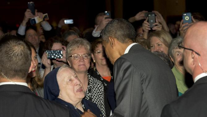 President Barack Obama greets a nun in the audience after speaking to the Catholic Hospital Association Conference at the Washington Marriott Wardman Park in Washington, Tuesday, June 9, 2015, about healthcare reform. (AP Photo/Carolyn Kaster)