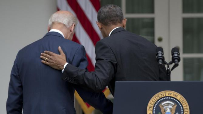 President Barack Obama and Vice President Joe Biden walk back to the Oval Office of the White House in Washington, Thursday, June 25, 2015, after the president spoke in the Rose Garden after the U.S. Supreme Court upheld the subsidies for customers in states that do not operate their own exchanges under President Barack Obama's Affordable Care Act. (AP Photo/Carolyn Kaster)
