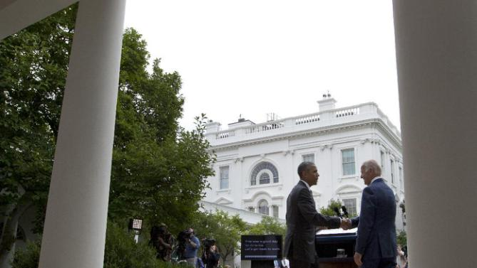 President Barack Obama and Vice President Joe Biden shake hands before walking back to the Oval Office from the the Rose Garden of the White House in Washington, Thursday, June 25, 2015, after the president spoke about the U.S. Supreme Court upholding the subsidies for customers in states that do not operate their own exchanges under President Barack Obama's Affordable Care Act. (AP Photo/Carolyn Kaster)