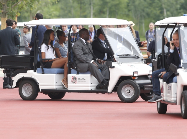 Malia, left, and Sasha Obama arrive at the Italian pavilion at the 2015 Expo in Rho, near Milan, Italy, Thursday, June 18, 2015.  U.S. first lady Michelle Obama is getting a guided tour of the Italian pavilion at the Expo 2015 world's fair from Premier Matteo Renzi's wife, and meeting with Italian schoolchildren. (AP Photo/Luca Bruno)