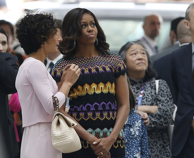 "Italy's first lady Agnese Landini,  left, welcomes U.S. first lady Michelle Obama,  for a visit at the Italian pavilion at the 2015 Expo in Rho, near Milan, Italy, Thursday, June 18, 2015. Mrs. Obama is leading a presidential delegation Thursday to the world's fair, organized around issues concerning food and nutrition, which dovetails with the U.S. first lady's ""Let's Move"" initiative to fight childhood obesity through diet and exercise. (AP Photo/Luca Bruno)"