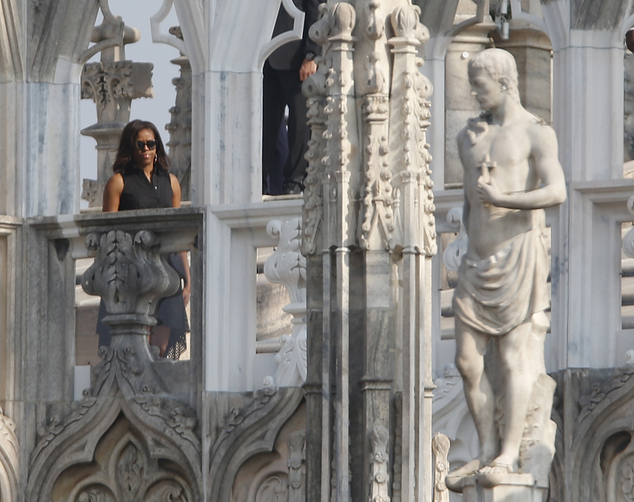 U.S. first lady Michelle Obama visits the roof of the Duomo gothic cathedral in Milan, Italy, Thursday, June 18, 2015. Earlier Michelle Obama  toured the U.S. and Italian pavilions at the Expo 2015 world's fair focused on food and nutrition, topics in step with the first lady's initiative to promote healthy eating.(AP Photo/Luca Bruno)