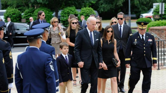 Vice President Joe Biden and his family arrive for the viewing of former Delaware Attorney General Beau Biden at Legislative Hall before a viewing in Dover, Del. Biden, the vice president's eldest son, died of brain cancer Saturday at age 46.  (Jason Minto/The Wilmington News-Journal via AP)  NO SALES