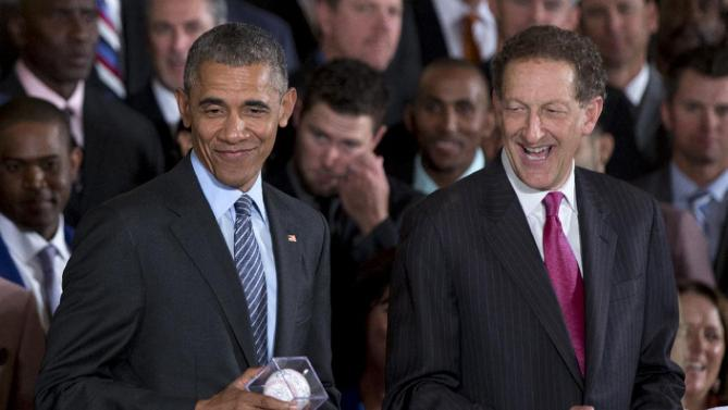 President Barack Obama, accompanied by San Francisco Giants CEO Larry Baer, right, holds an autographed baseball given to him by San Francisco Giants pitcher Madison Bumgarner during a ceremony in the East Room of the White House in Washington, Thursday, June 4, 2015, where the president honored the 2014 World Series baseball champions. (AP Photo/Carolyn Kaster)