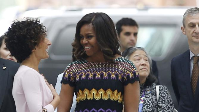"""Italy's first lady Agnese Landini,  left, welcomes U.S. first lady Michelle Obama,  for a visit at the Italian pavilion at the 2015 Expo in Rho, near Milan, Italy, Thursday, June 18, 2015. Mrs. Obama is leading a presidential delegation Thursday to the world's fair, organized around issues concerning food and nutrition, which dovetails with the U.S. first lady's """"Let's Move"""" initiative to fight childhood obesity through diet and exercise. (AP Photo/Luca Bruno)"""