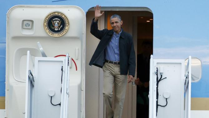 President Barack Obama waves as he steps off Air Force One as he arrives Monday, June 8, 2015, at Andrews Air Force Base, Md., as he returns from the G-7 Summit in Germany. (AP Photo/Alex Brandon)