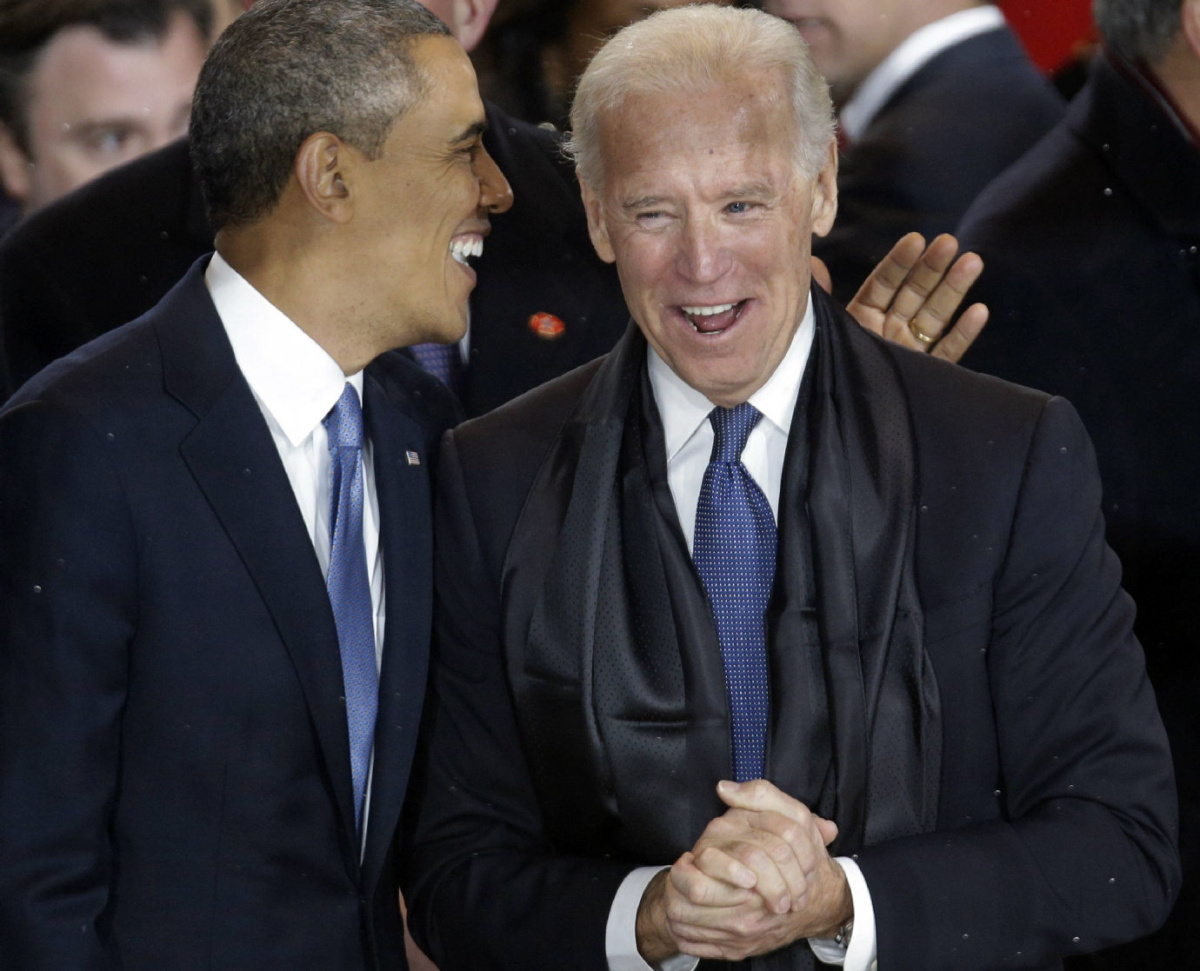 President Barack Obama talks with Vice President Joe Biden in the presidential box during the inaugural parade down Pennsylvania Avenue en route to the White House, Monday, Jan. 21, 2013, in Washington. Thousands marched during the 57th Presidential Inauguration parade after the ceremonial swearing-in of President Barack Obama. (AP Photo/Gerald Herbert)