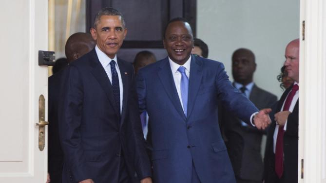 President Barack Obama is escorted into a bilateral meeting by Kenyan President Uhuru Kenyatta at the State House, on Saturday, July 25, 2015, in Nairobi. Obama's visit to Kenya is focused on trade and economic issues, as well as security and counterterrorism cooperation.  (AP Photo/Evan Vucci)