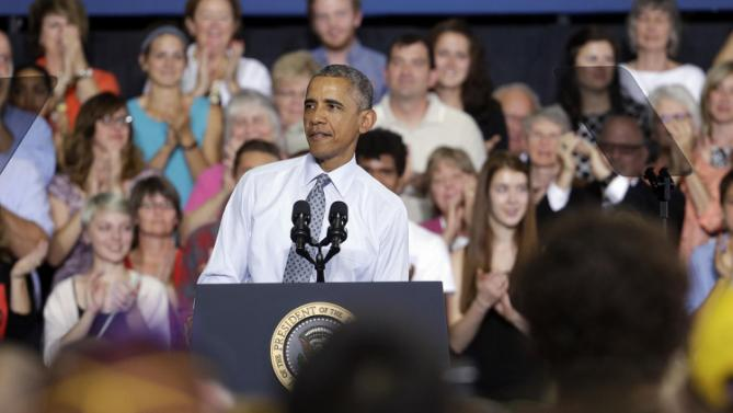 President Barack Obama pauses while speaking at the University of Wisconsin at La Crosse, in La Crosse, Wis., Thursday, July 2, 2015, about the economy and to promote a proposed Labor Department rule that would make more workers eligible for overtime. (AP Photo/Morry Gash)