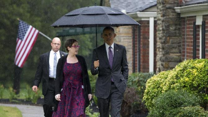 President Barack Obama walks with Kelly Bryant at her home in Nashville, Tenn., Wednesday, July 1, 2015, en route to Taylor Stratton Elementary School, where he is to speak about the Affordable Care Act.  (AP Photo/Carolyn Kaster)