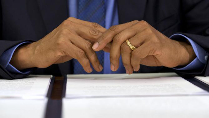 President Barack Obama's hands are seen before he signs the designation of three new national monuments; Berryessa Snow Mountain in California, Waco Mammoth in Texas, and the Basin and Range in Nevada, in the Oval Office of the White House Friday, July 10, 2015, in Washington. (AP Photo/Jacquelyn Martin)
