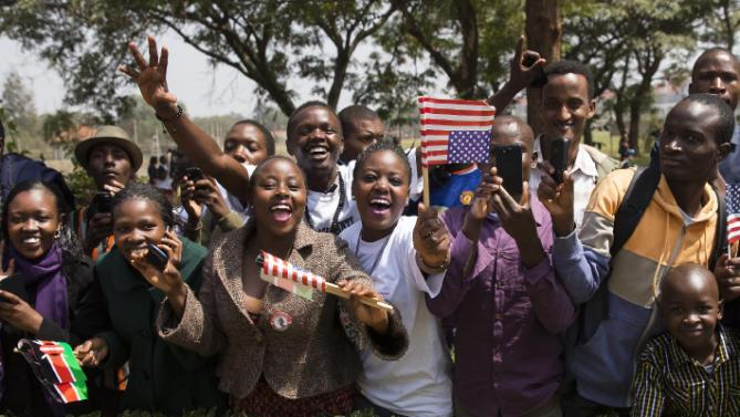 People cheer as the motorcade of President Barack Obama passes by on the way to deliver a speech at Safaricom Indoor Arena, Sunday, July 26, 2015, in Nairobi. On the final day of his visit in Kenya, Obama laid out his vision for Kenya's future, and broad themes of U.S.-Kenya relations. (AP Photo/Evan Vucci)