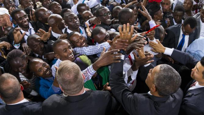 President Barack Obama, bottom right, shakes hands after delivering a speech at Safaricom Indoor Arena, Sunday, July 26, 2015, in Nairobi. On the final day of his visit in Kenya, Obama laid out his vision for Kenya's future, and broad themes of U.S.-Kenya relations. (AP Photo/Evan Vucci)