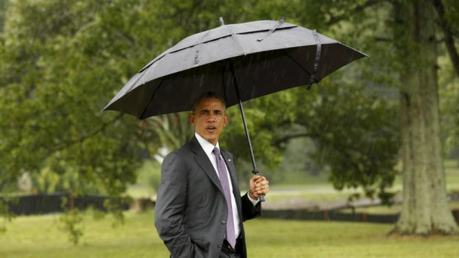 U.S. President Barack Obama walks to the home of Kelly Bryant to take her to the event where Obama was to speak about the Affordable Care Act during a visit to Taylor Stratton Elementary School in Nashville,  Tennessee July 1, 2015. Bryant is a breast care survivor who wrote Obama a letter to tell of her positive experience with the Affordable Care Act.  REUTERS/Kevin Lamarque