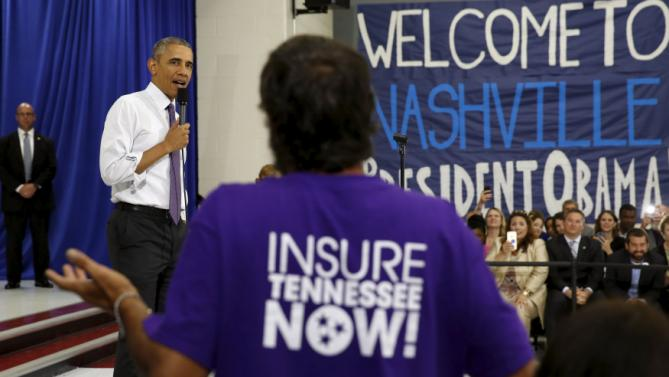 U.S. President Barack Obama takes a question as he speaks about the Affordable Care Act during a visit to Taylor Stratton Elementary School in Nashville, Tennessee July 1, 2015. REUTERS/Kevin Lamarque
